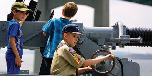 Kid at the Helm 500x250 - Battleship Cove - Fall River, MA