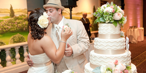 Wedding Cake & Kiss - Cape Codder Resort & Spa - Hyannis, MA - Credit Angela Greenlaw Photography